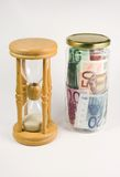 Time is money. Sand clock and Euro notes royalty free stock photos