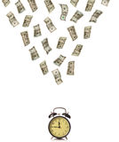 Time is money. Money raining over an old alarm clock Stock Image