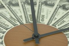 Time is money. Banknotes lying on a dial and Stock Photo