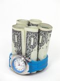 Time is Money. Wrist watch and doller bills stock photos