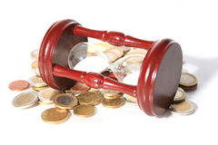 Time is money. Time is money concept. Euro coins and sand watch Stock Photos