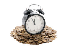 Time is money. Alarm clock with coins. Clipping path included Royalty Free Stock Photography