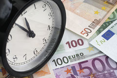 Time is money. Alarm clock and euro banknotes Royalty Free Stock Photos