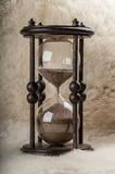 Time is money. Antique hourglass. stock image