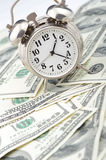 Time - money. Business concept. Analog hours on a heap of paper dollars Royalty Free Stock Images