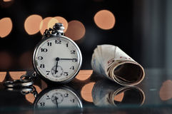 Time and money. business concept. On a bokeh background Royalty Free Stock Photos