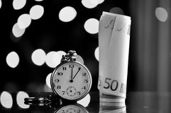 Time and money. business concept. On a bokeh background Stock Photography