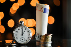 Time and money. business concept. On a bokeh background Royalty Free Stock Photography