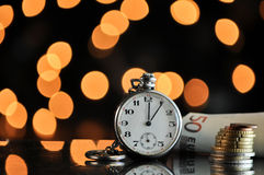 Time and money. business concept. On a bokeh background Royalty Free Stock Photo