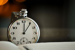 Time and money. business concept. On a bokeh background Stock Photos