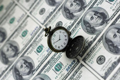 Time is money. Business concept Time is money. Clock over dollars background Royalty Free Stock Photo