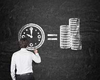 Time is money. Businessman in room drawing time is money concept royalty free stock photos