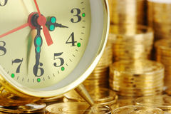 Time is money - clock dial and golden coins Royalty Free Stock Image