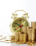 Time is money - clock dial and golden coins Stock Photography
