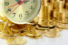 Time is money - clock dial and golden coins Stock Photo