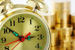 Time is money - clock dial and golden coins Stock Image