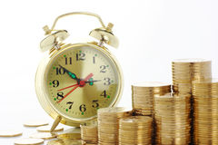 Time is money - clock dial and golden coins Royalty Free Stock Photo