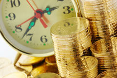 Time is money - clock dial and golden coins Stock Images