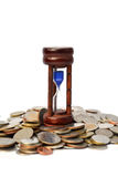 Time is money coins with sandwatch Stock Image