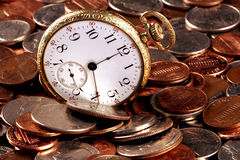 Time And Money Concept. Concept image about time and money. An old pocket-watch and US coins Stock Photos