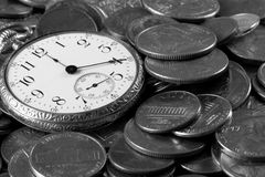 Time And Money Concept. A black and white concept image portrayal of investment and business strategy. An old pocket-watch and US coins Stock Photo