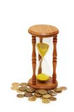 Time is money concept. Hourglass and coins Royalty Free Stock Photos