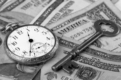 Time And Money Concept. Conceptual keys to success of time and money Stock Photos
