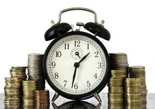 TIME IS MONEY concept: alarm clock and euro coins Royalty Free Stock Images