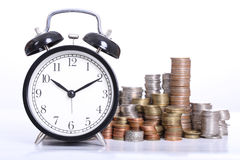 Time is Money concept with clock and coins stack Stock Image