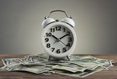 Time is money. Concept with clock and dollars Stock Image