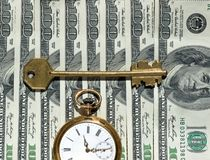 Time and Money concept image. US currency, watch, key - as concept of  Financial Success Stock Image