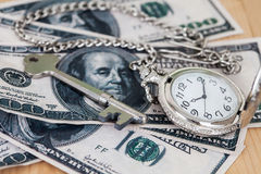 Time and money concept image - old silver pocket watch Stock Photos