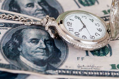 Time and money concept image - old silver pocket watch Stock Image