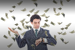 Time is money concept with man looking at watch Stock Photography