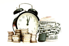 Time and money concept old style. Time and money concept with coins and banknotes rapped in chains and clock in the background, all isolated on white, old style Stock Photography
