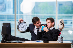 The time is money concept with two businessman Stock Image