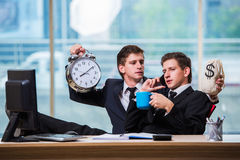 The time is money concept with two businessman Stock Photo