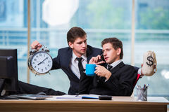 The time is money concept with two businessman Stock Images