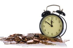 Time is money, concept with uk coins Stock Photo