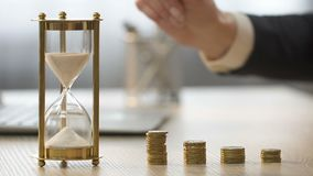 Time is money. Female in suit putting coin on the table, lady working at office stock footage