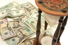 Time is money - Hourglass and Dollar Cash Royalty Free Stock Image