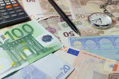 Time is money. Money laying on a desk, time is money, il tempo è denaro stock images