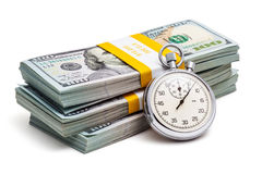 Time is money. Loan concept background - stopwatch and stack of new 100 US dollars 2013 edition banknotes bills bundles isolated on white Royalty Free Stock Image