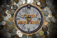 Time is Money - Metal Clock and Coins Stock Image