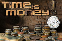Time is Money - Old Watch and Coins Stock Photography