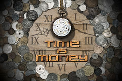 Time is Money - Old Watch and Coins Stock Image