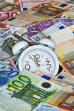 Time is Money with clock and Euro Bank notes Stock Photos