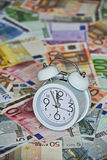 Time is Money with clock and Euro Bank notes Stock Image