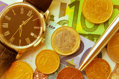 Time Is Money. Photo of watches  Money and pen . Concept and Ideas Royalty Free Stock Photo