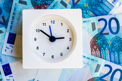 Time is money. The representation of idioms: time is money Royalty Free Stock Photography